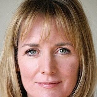 Author / Speaker holding image - Caroline Langrishe