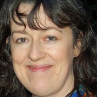 Author / Speaker holding image - Suzi Feay